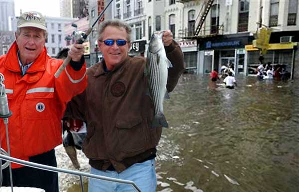 Photo of George and George fishing in 'Nawlins'  during Katrina.  With smiles on their faces, Sr. holds the rod and Jr. holds a fish, on a boat, while African Americans, in the background, wade through the flooded streets. (Spoof)