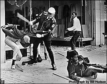 Civil Rights Photo by Bill Hudson showing peace officer clubbing an African American for no reason.