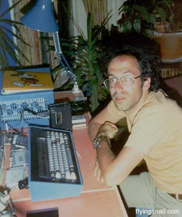 Andy Ross siting at ~@~'s home in front of an IMSAI 8080