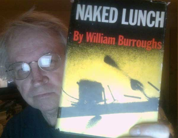 Steven Leech with one of his prize possessions ... a copy of the 1959 original first edition book, Naked Lunch by William S. Burroughs
